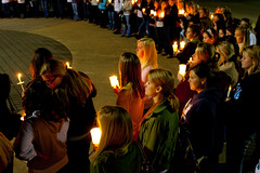 Image of crowd holding candles for a vigil.
