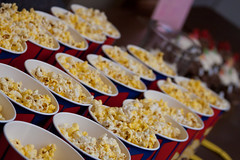 Image of rows of buckets of popcorn on a table.