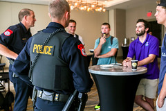 Image of JMU students sharing coffee with police officers.