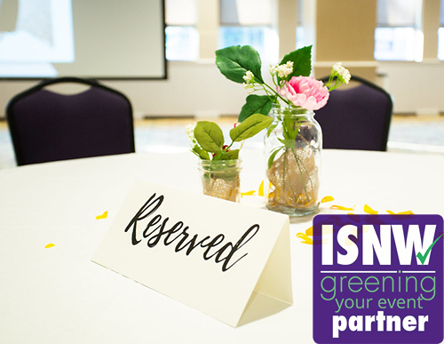Image of a table with a reserved sign and centerpiece