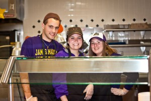Photo of JMU students working as dining services employees in the Festival food court.