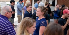 Photo of JMU students and staff enjoying an outdoor ice cream social event.