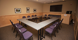 Image of a conference room with tables situated into a square