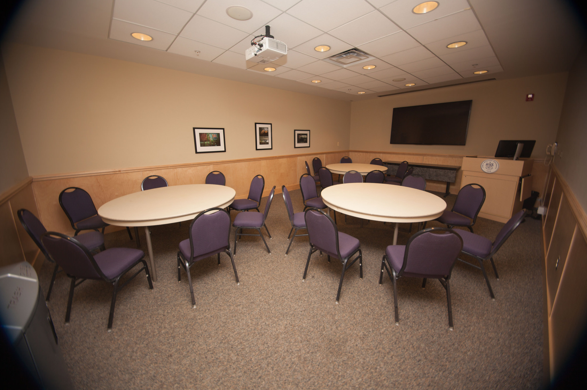 Photo of a small conference room with banquet setup.