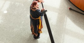 Photo of a woman doing live action role playing at MadicCon.