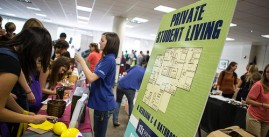 Image of people interacting at an information fair.