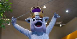 Image of Duke Dog, the JMU Mascot, with his arms up, cheering