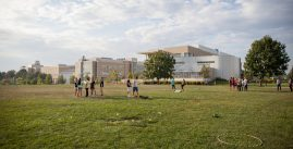 JMU students playing outdoor games on the lawn at Festival Conference and Student Center.