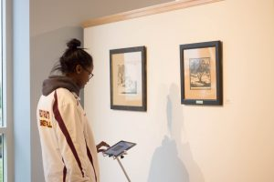 Student viewing art works at the Lisanby