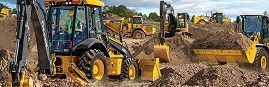 Image of construction vehicles moving dirt