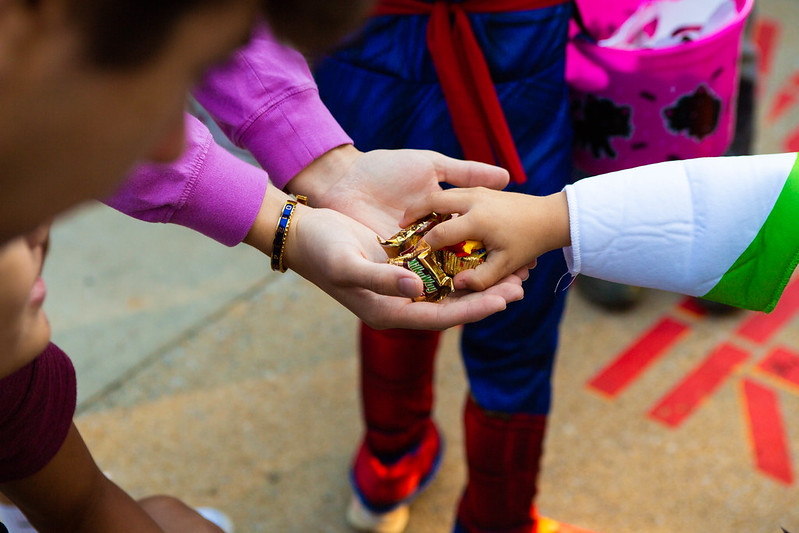 Image of a child being handed candy
