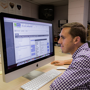 Photo of a student using the EMS website to book an event