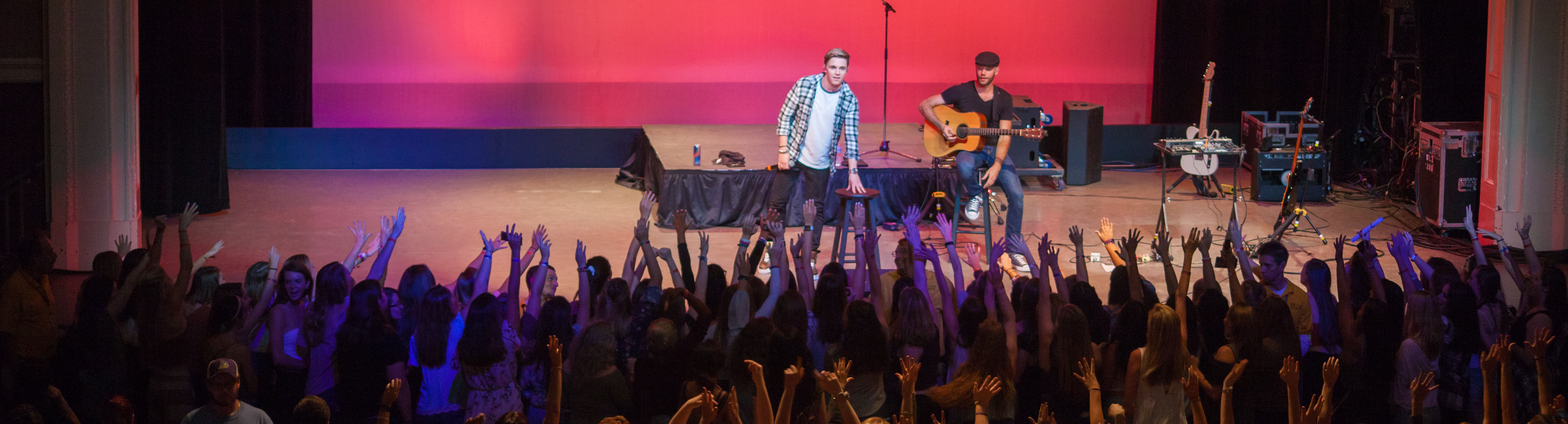 Jesse McCartney and another performer onstage for UPB in 2017