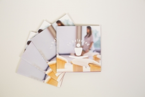 A photo of three stacked brochures on a white background.