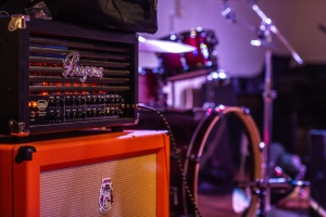 Image of stacked amps on a stage.