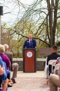 Image of Vice President of Student Affairs Tim Miller gives a speech on the Warner Commons.