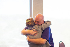 Image of Sue Bauer Hugging Bob Davis at her retirement party