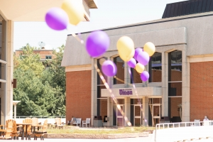 Image of balloons blowing in front of Madison Union