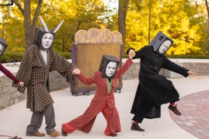 Image of performers at Get Down at Sundown dancing with masks