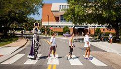 Duke Dog and Students crossing the road in front of madison union like Abbey Road