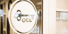 Image of OCL logo, a key and letters, on a window