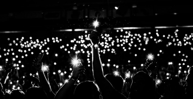 Image of audience with cellphones out during a song
