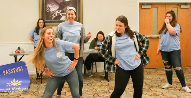 Image of UPB Staff dancing during an event