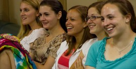 Image of five students laughing at a comedy performance