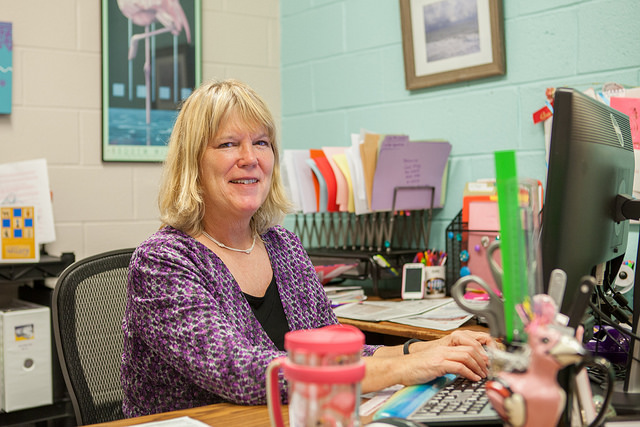 Gail May at her office desk