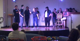 Image of a group of students performing a show on the TDU stage.