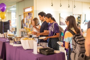 Image of students getting food from a nacho buffet