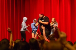 Image of Daniel Franzese on stage with fans dressed as Damien from Mean Girls