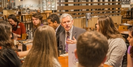 Image of President Alger talking with students
