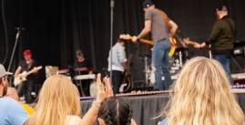 Image of students in watching a musician on stage
